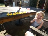 Little girl with toy ducks