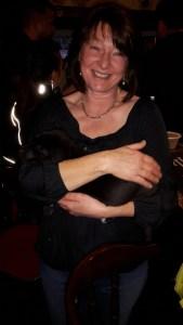 Lady holding a dog