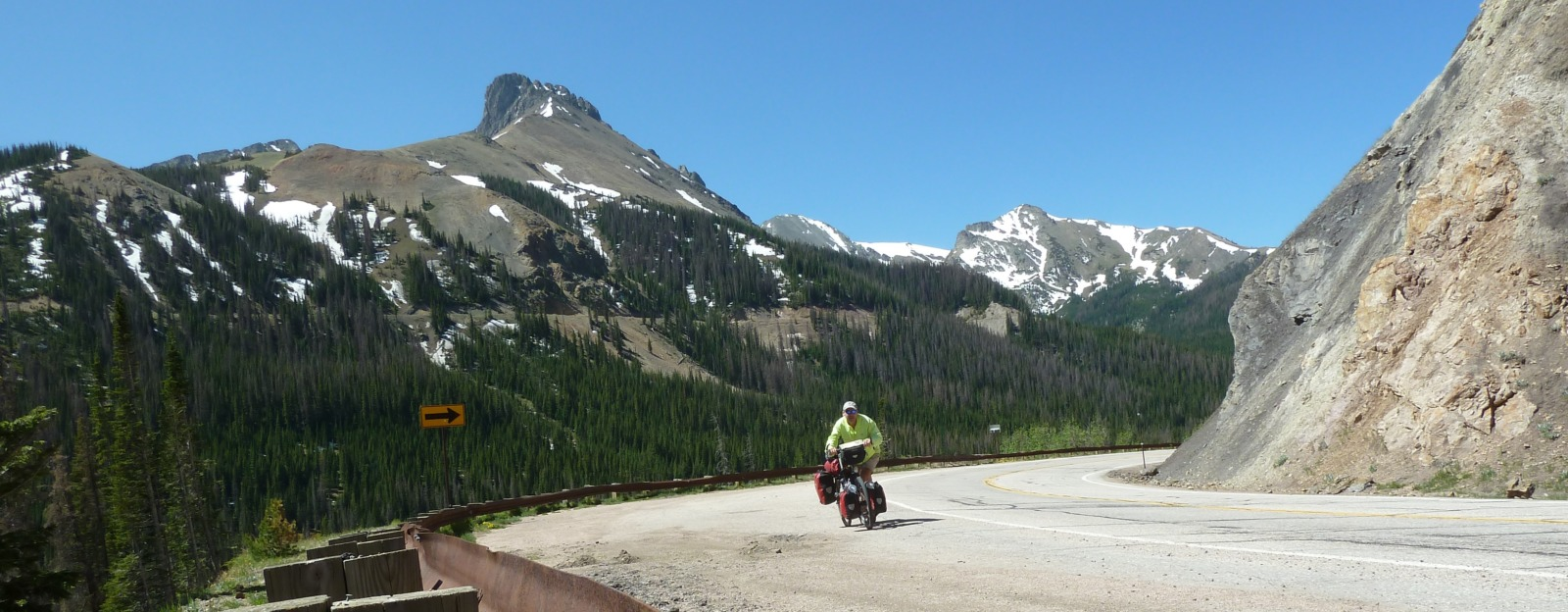 Man cycling on a mountainous road