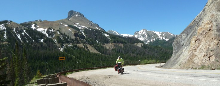 Man cycling on a mountainous road