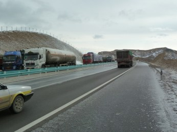 Trucks on icy road