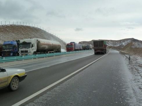 Trucks on icy road