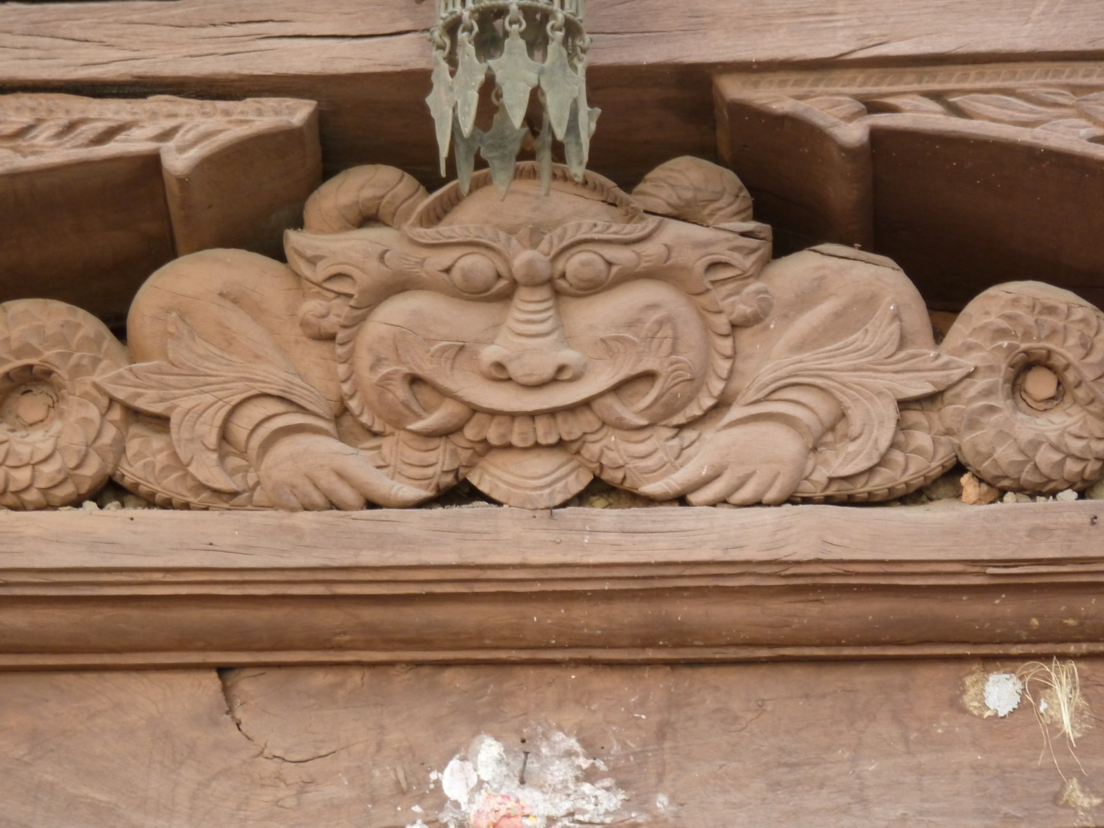 Wooden carving of a diety in Durbar Square Kathmandu.