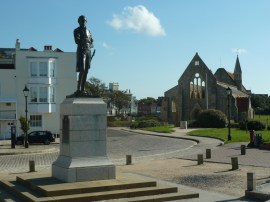 Statue of Lord Nelson with the Royal Garrison Church