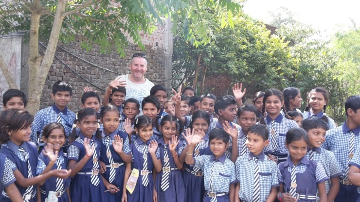 Garry McGivern meeting some school children at a school in Sagar