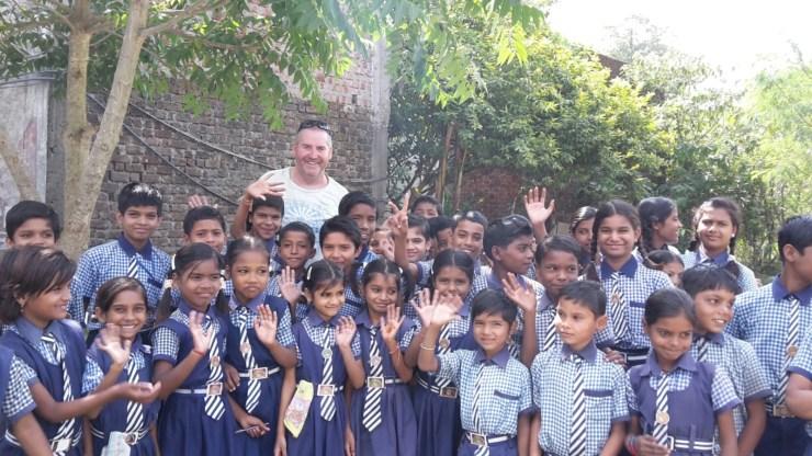 Garry McGivern with some school children