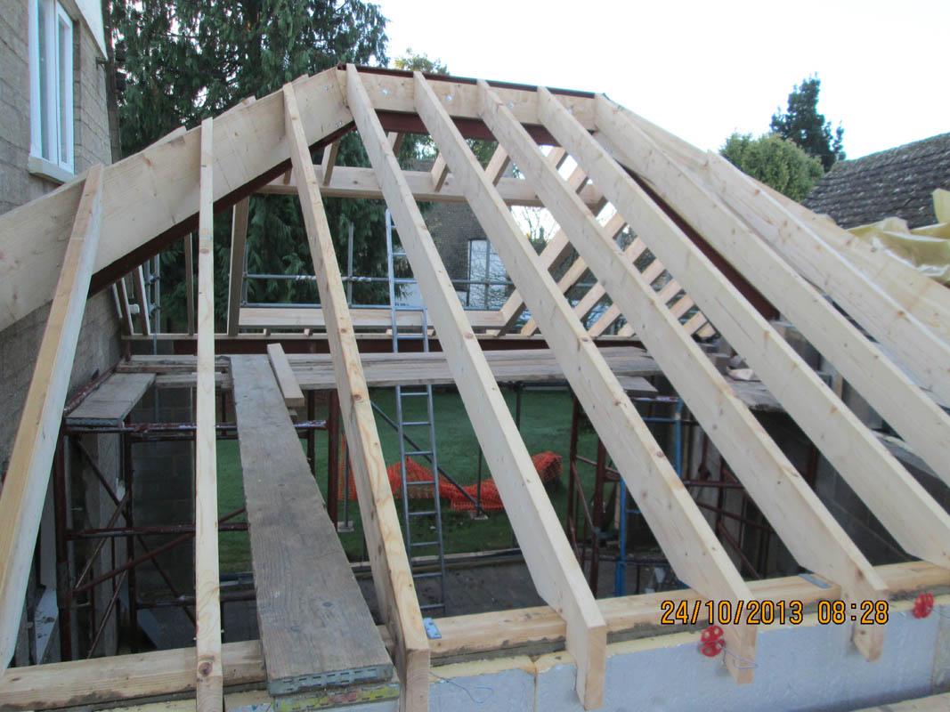 Rear through elevation of hipped cut roof roof design due to existing gable window