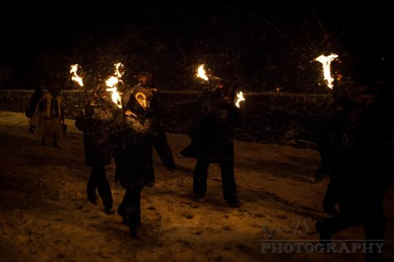Fox characters carrying flaming torches