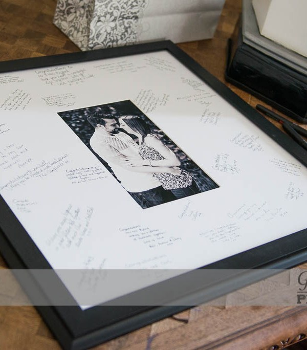 An image from our pre-wedding shoot used as a signing board