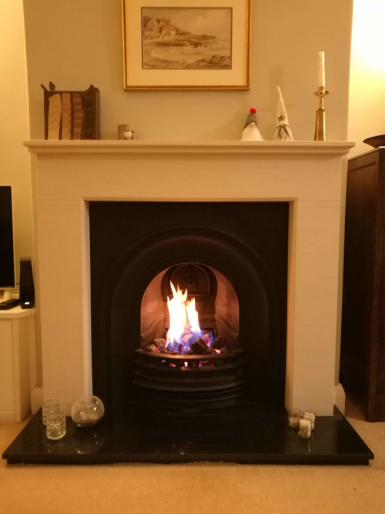 Felipe limestone surround with Stovax cast gas fire