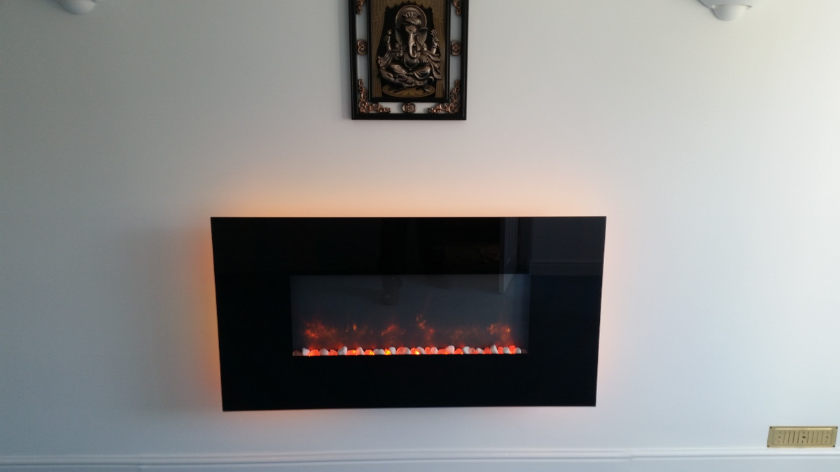 Radiance electric fire with black glass trim