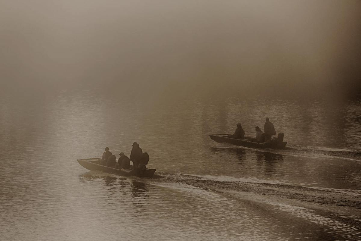 Photo of Early-Morning Anglers. Click Here to Learn About the Benefits of Fishing.