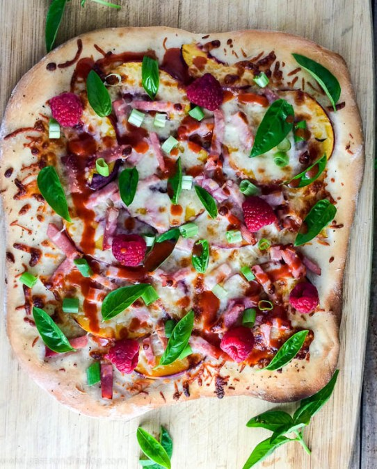 Peach and Raspberry Pizza on wooden cutting board