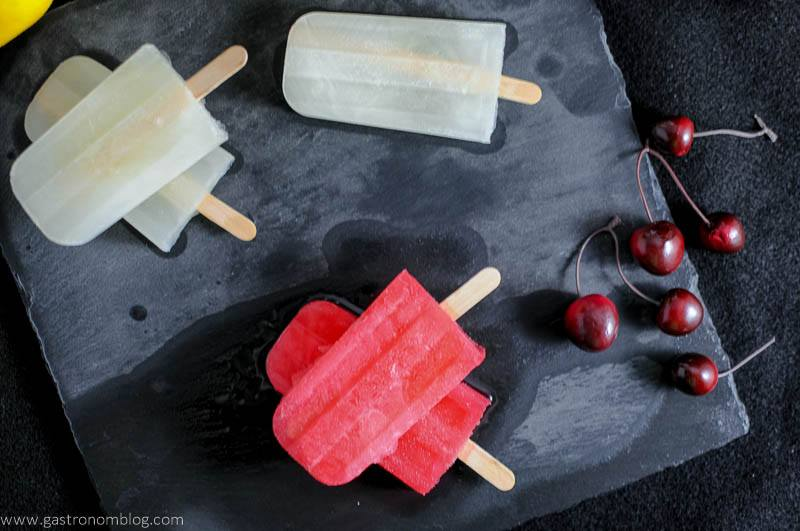 A pair of boozy popsicles, perfect for summer, Jasmine Lemonade Gin Pop and a Cherry Limeade Vodka Pop