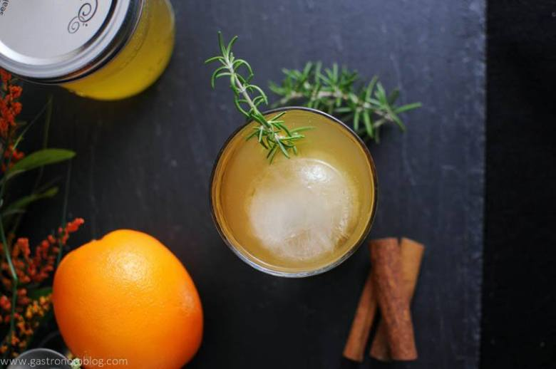 Earl of Orange Cocktail with rosemary, cinnamon sticks, orange and mason jar