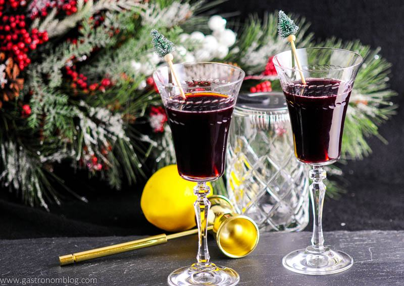 Two Recap Cocktails, made with Bin 27 Port Wine, amaro, mint and lemon sits in front of holiday decor.