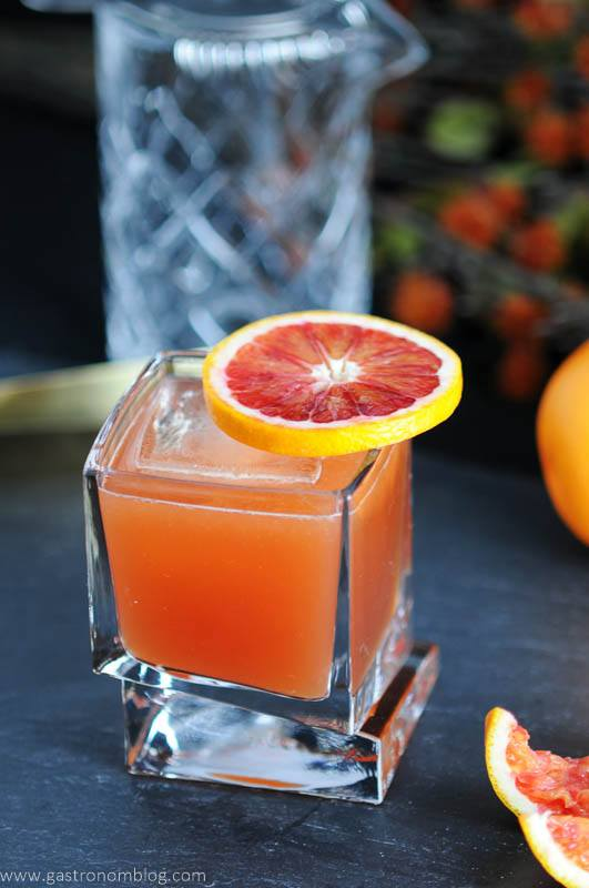 Blood and Bourbon, made with fresh squeezed Blood Orange Juice, Bourbon, Simple syrup and a dash of lemon. Finished with aromatic bitters. Glass by Joy Jolt.