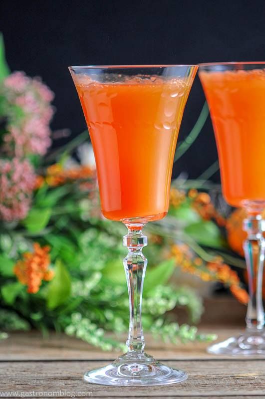 Two Carrot Ginger Mimosas in Rolf Glass Gatsby Cocktail Flutes and spring flowers and easter eggs