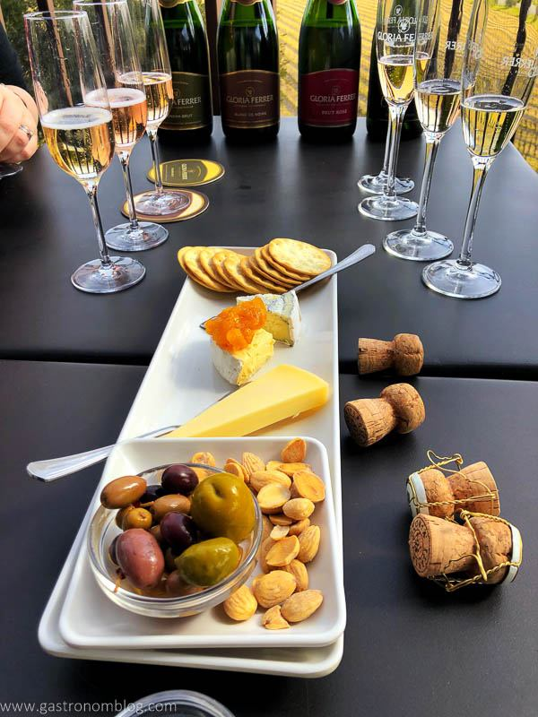 A tray of cheese, crackers, preserves, nuts and olives are the perfect pairing to sparkling wine at Gloria Ferrer Vineyards.