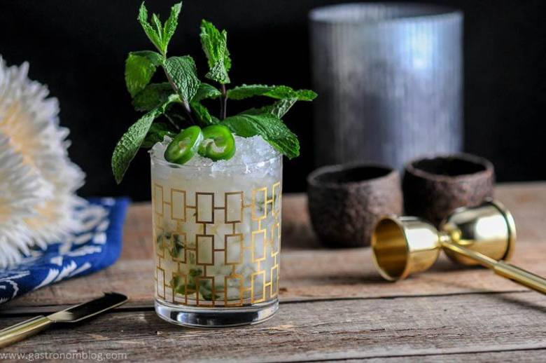 The Mexican Mint Julep is a mezcal cocktail served in a rocks glass and topped with jalepeno and fresh mint.