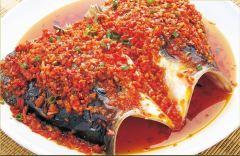 Cabeza de pescado en salsa picante