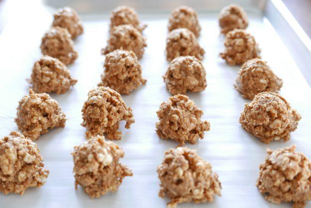 no bake peanut butter balls arranged on a baking sheet