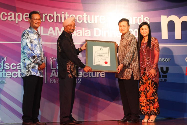 Proud moment: Lim Beng Weh, Director of Finance (second from right) and Connie Chin, Director of Marketing Communications (first from right) of Philea Resort and Spa receiving the award from Works Ministry secretary-general Datuk Himmat Singh (second from left) and Mohd Fadrillah Mohd Taib (first from left), president of the Institute of Landscape Architects Malaysia, the awards' organizer.