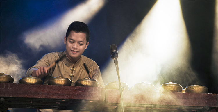 A member of Rhythm of Borneo playing traditional instrument.