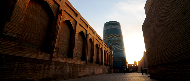 An etheral perspective taken within Khiva's ancient walled city, with the imcomplete minaret in the background