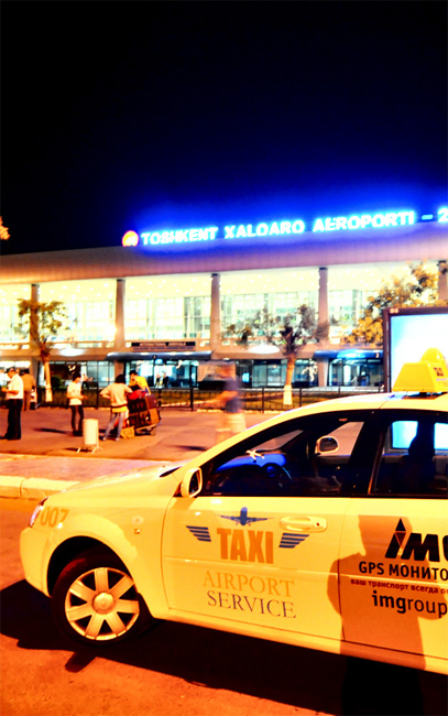 The facade of Tashkent International Airport at night