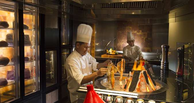 Chefs preparing delectable seafood on skewers at Chambers Bar & Grill