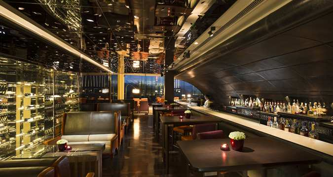 Hilton Kuala Lumpur's The Bar is located right under the escalator, sporting sharp and trendy look