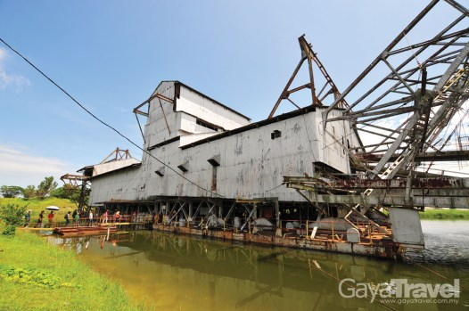 This dredge was built in England in 1938 by F.W. Payne & Sons, a major design engineering company in bucket line dredges at that time.