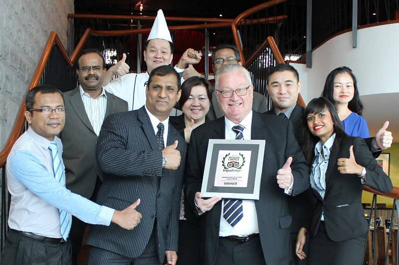 Ramada Plaza Dua Sentral Kuala Lumpur General Manager Ian Hurst (second from right) and his Management Team celebrating the award by TripAdvisor