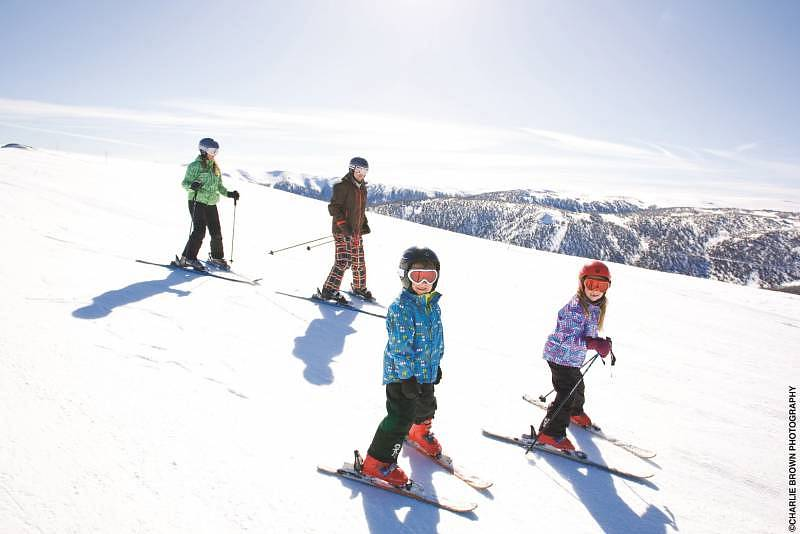 A family skiing at Falls Creek