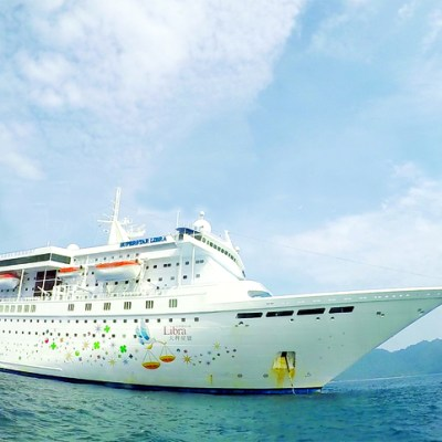 The regal SuperStar Libra cruising on Andaman waters and drops anchor near MacLeod Island, Myanmar