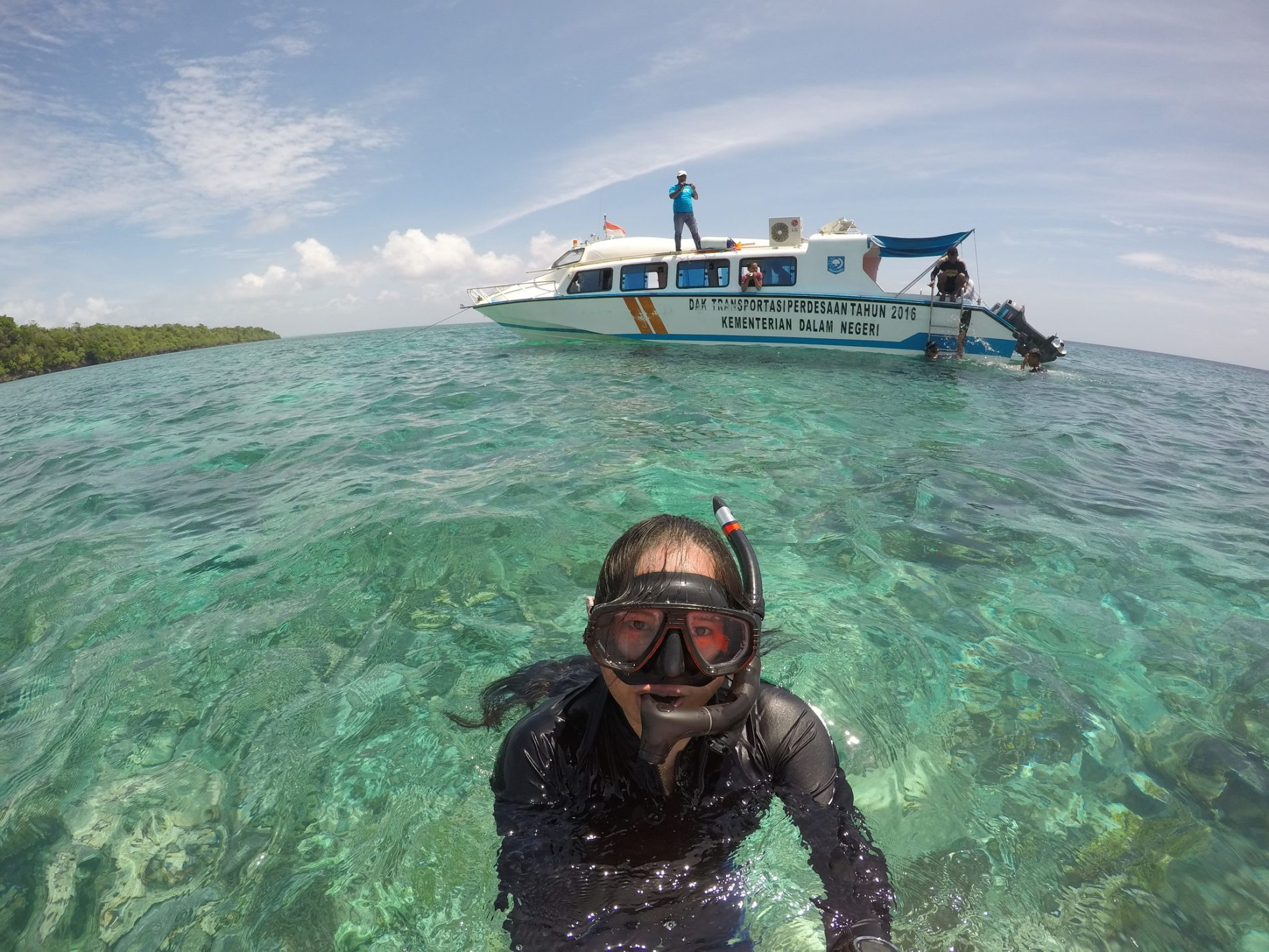 Swimming in the crystal clear water of Adranan Island