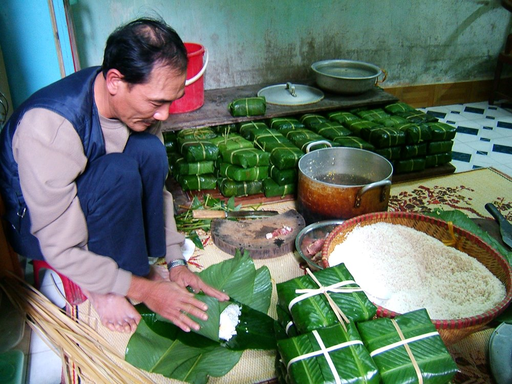 Excite your taste buds with local delicacies reserve especially for the Tet celebrations, such as the Banh Chung – a square glutinous rice cake wrapped in green leaves and cooked with meat and beans.