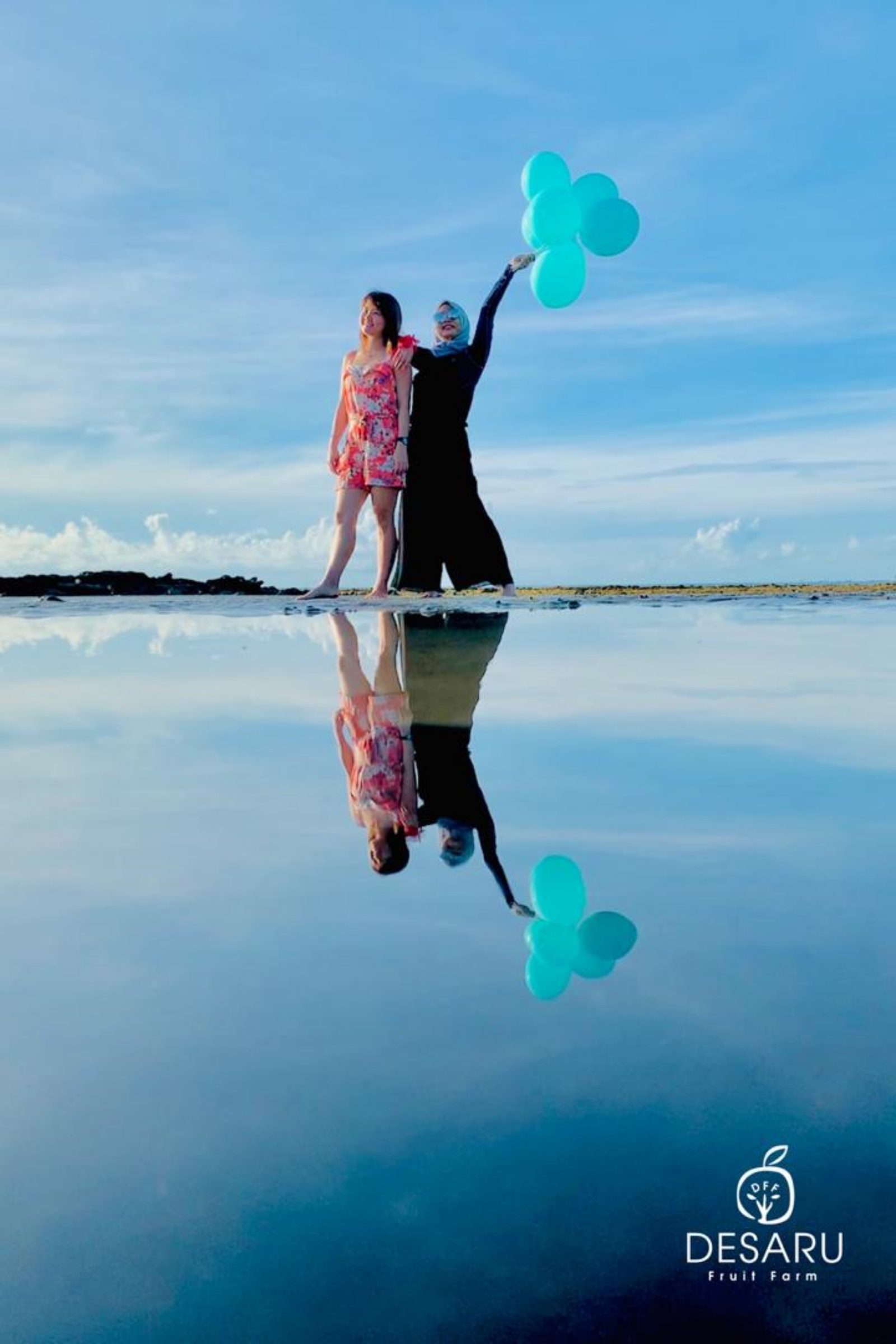 Bring the colourful props and find your best shot of mirror-like reflection of the sky at Desaru Sky Mirror during low tide (Photo by Desaru Fruit Farm)