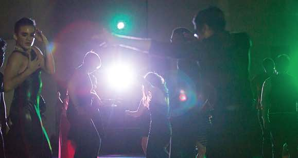 Photo of youth dancing in spotlight