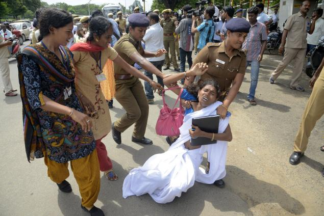Police assaulting protesting transgenders in Tamil Nadu (Pic by S.R. Raghunathan via The Hindu)