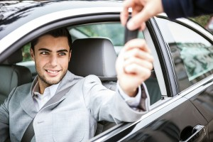 bigstock-Man-taking-car-key-41217067