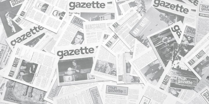 The collection of print Gazettes since 1968 spread out on the floor to create a collage.