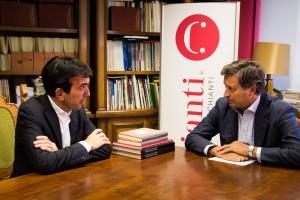 Il ministro Maurizio Martina e il presidente Giovanni Busi