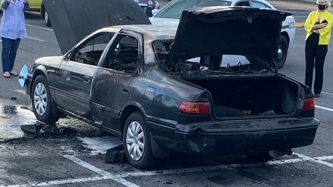 Driver's car goes up in flames after he used hand sanitizer while smoking