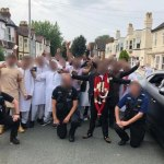 Police slammed after posing for Photos instead of doing their job