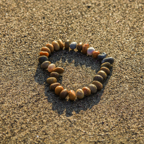 heart from stones on beach
