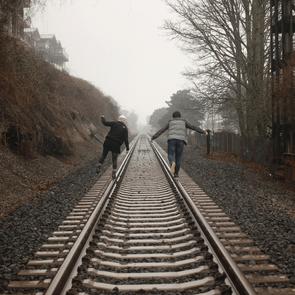 balance on train tracks