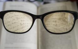 glasses magnifying book