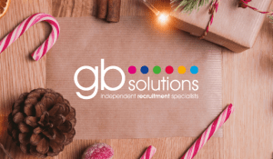 gb solutions written on paper, surrounded by candy canes